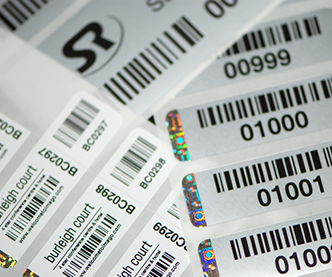 Barcode labels with a hologram