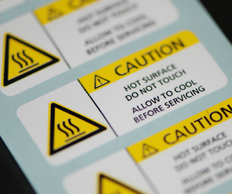High temperature labels with yellow and black print