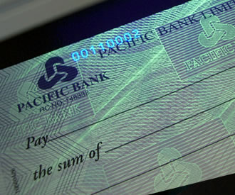 Printed Cheque Showing Security Features UV Fluorescing